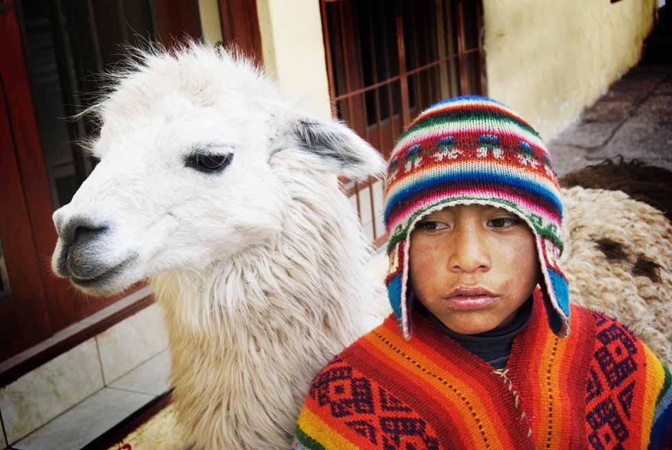 PhotoFly Travel Club | Peru Boy and his lamma | PhotoFly Travel Club