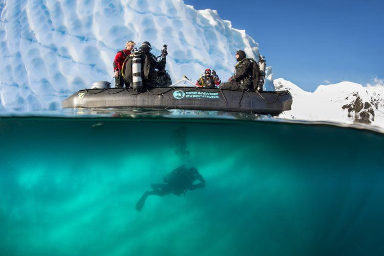 PhotoFly Travel Club   Polar-Diving-zodiac-in-front-of-iceberg-diver-diving-under-zodiac-Antarctica_Peter-de-Maagt-750×500   PhotoFly Travel Club